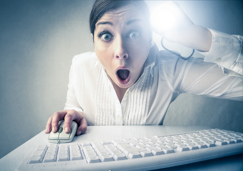 Shocked girl at the computer